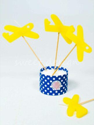 Vela amarilla con forma de avión